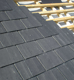 Part way through a slate roof in Gillingham